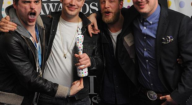 Mumford And Sons have postponed gigs in the US while bassist Ted Dwane has surgery on a blood clot