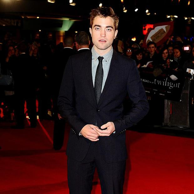 Robert Pattinson has reportedly turned to music after his romance split