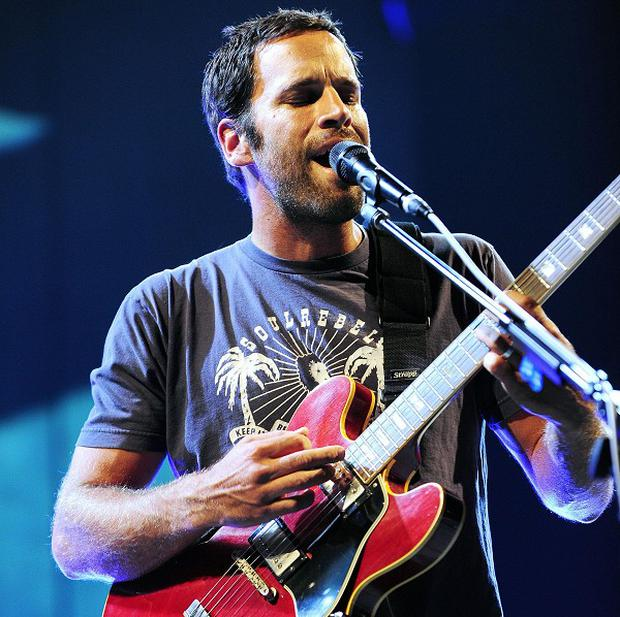 Jack Johnson will fill in for Mumford and Sons at the Bonnaroo festival