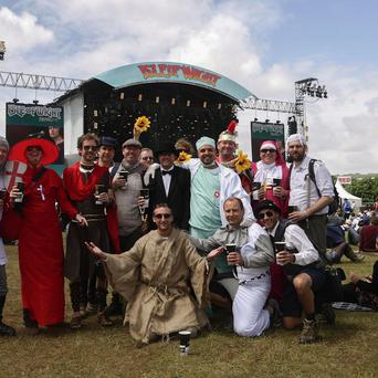 Revellers in fancy dress attend the Isle of Wight Festival, in Seaclose Park, Newport