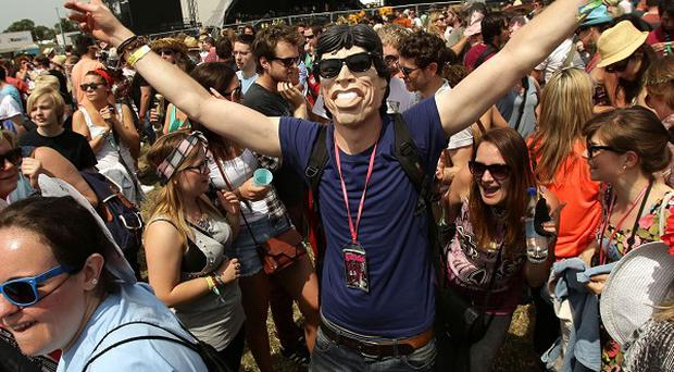 Festival goers dancing during a Jagger off flash mob at Glastonbury