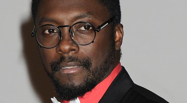 Will.i.am says Pharrell's trademark is too similar to his own