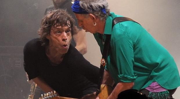 Mick Jagger and Keith Richards from the Rolling Stones perform on the Pyramid Stage