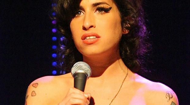 Amy Winehouse's mum said the singer was bored of her routine before her death