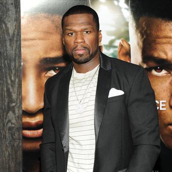 50 Cent has cancelled his visit to the UK after being charged with domestic violence