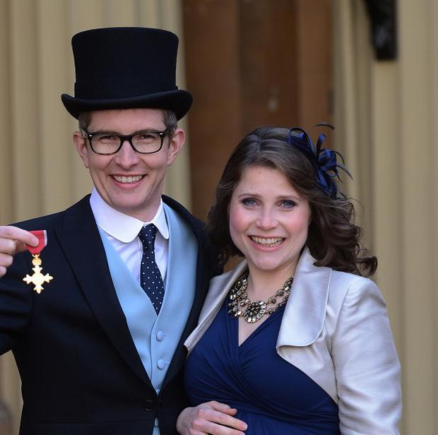 Gareth Malone and his wife Rebecca at Buckingham Palace, where the choirmaster collected his OBE