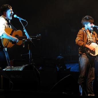 Marcus Mumford and Winston Marshall of Mumford & Sons perform on the Pyramid Stage at Glastonbury