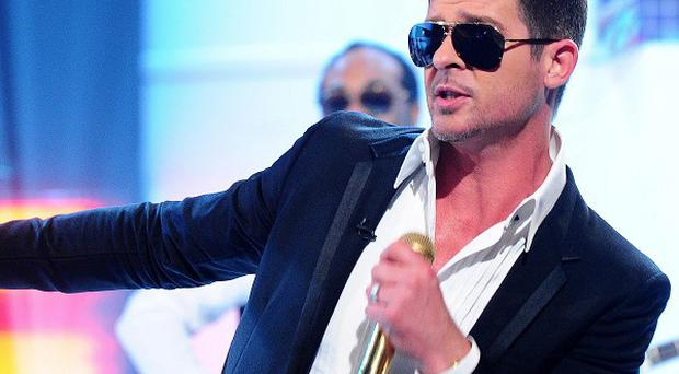 Robin Thicke's sixth studio album Blurred Lines has topped the official albums chart