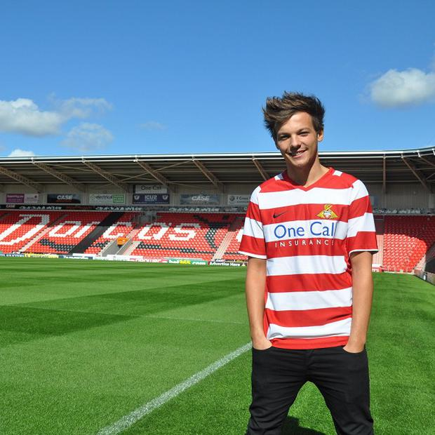 Louis Tomlinson of One Direction has signed to Doncaster Rovers FC