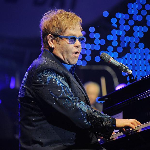 Sir Elton John is recovering after an operation