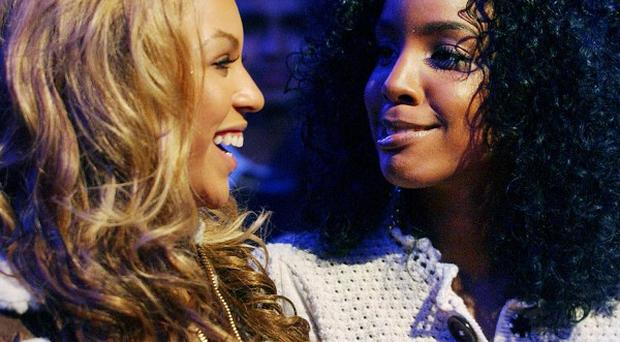 Kelly Rowland is happy for Destiny's Child bandmate Beyonce