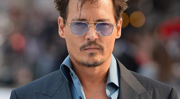 Johnny Depp has been spotted in a recording studio with Ed Sheeran