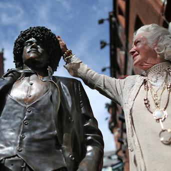 Philomena Lynott, mother of Irish musician Phil Lynott with his statue in Dublin