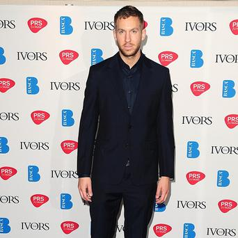 Calvin Harris says girlfriend Rita Ora isn't a fan of his music