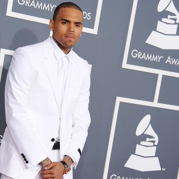 Chris Brown has had his probation rescinded and will now carry out a 1,000 hour community service order