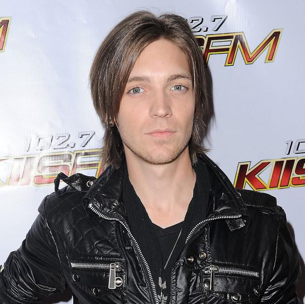 Alex Band was outside a store when he was reportedly attacked (AP)