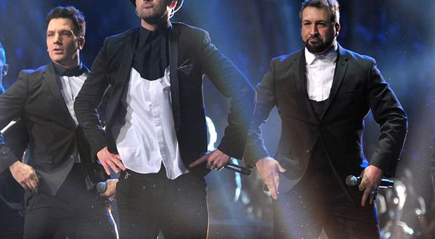 Justin Timberlake performs with fellow N Sync members, from left, Lance Bass, JC Chasez, Joey Fatone and Chris Kirkpatrick (AP/MTV)