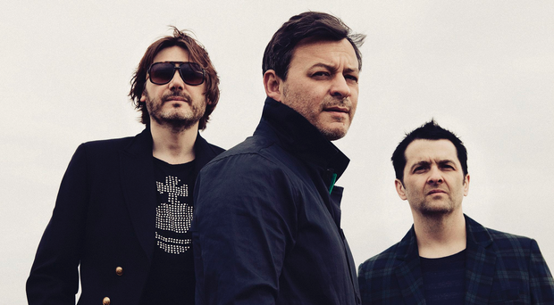 Not so Manic now: (from left) Nicky Wire, James Dean Bradfield and Sean Moore