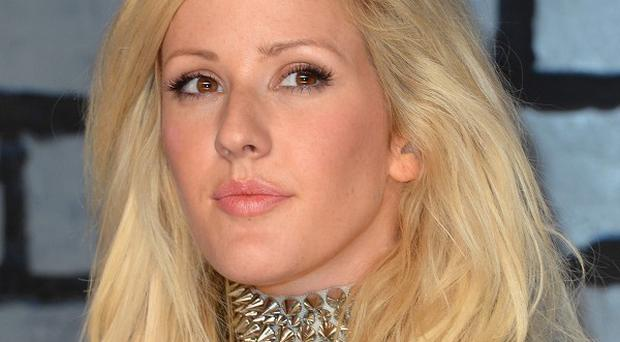Ellie Goulding continues to top the singles chart with her track Burn
