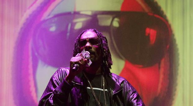 Snoop Dogg performing on the Main Stage at Bestival, held at Robin Hill Country Park on the Isle of Wight