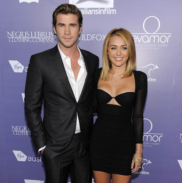 Liam Hemsworth and Miley Cyrus met on the set of The Last Song (Chris Pizzello/Invision/AP)