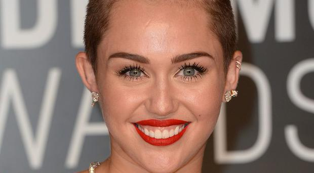 Miley Cyrus' dad says she has taken her profile to the next level in recent weeks