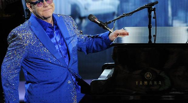 Elton John finds playing new songs at gigs sends fans running for the loo
