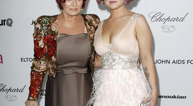 Sharon Osbourne criticises Lady Gaga in her autobiography after some of the pop star's fans targeted daughter Kelly