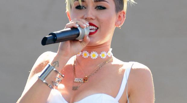 Miley Cyrus has been threatened with legal action by Sinead O'Connor