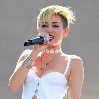 Miley Cyrus poked fun at her VMA performance during her SNL appearance