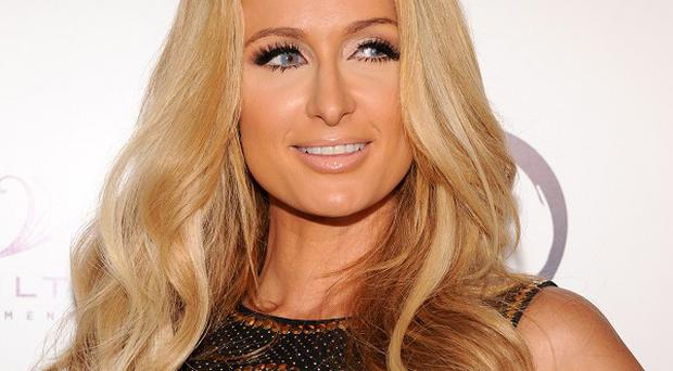 Paris Hilton played her new single during her DJ set in a Hollywood club
