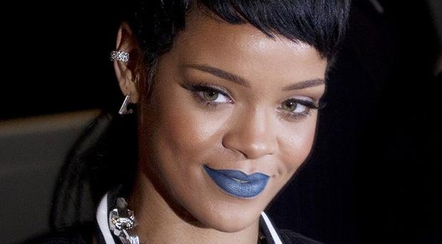 Rihanna has hit out at intrusive snappers