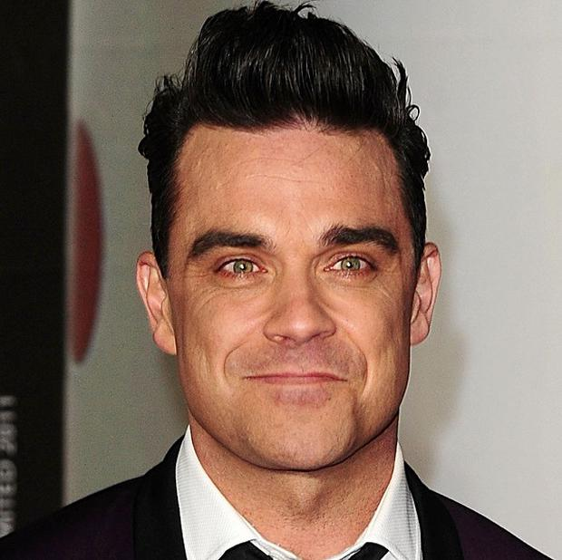 Robbie Williams admits fatherhood is scary