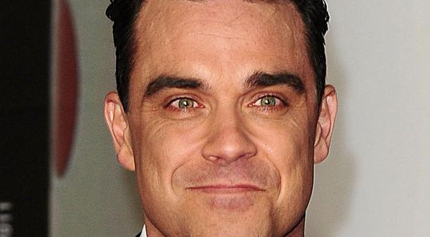 Robbie Williams' new single is dedicated to his daughter