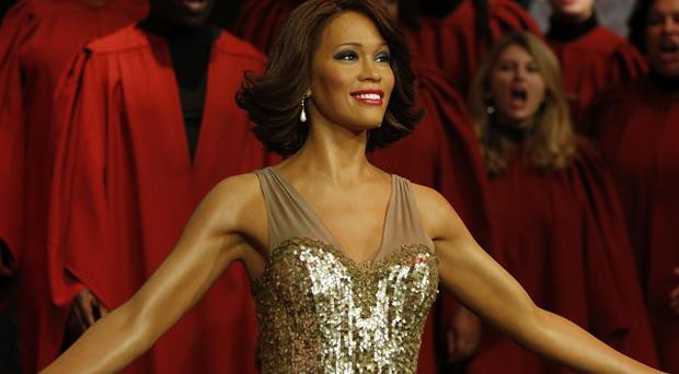 Whitney Houston's waxwork was welcomed to London by a gospel choir