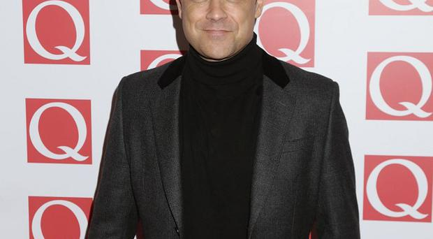 Robbie Williams was working the silver fox look at the Q Awards