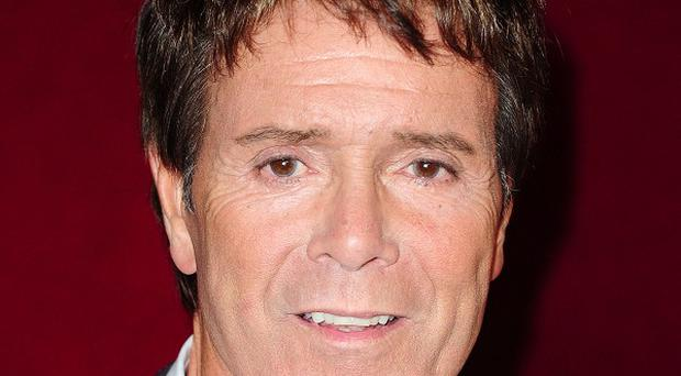 Sir Cliff Richard is top of the pops when it comes to mugs