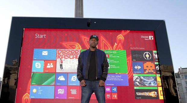 Dizzee Rascal is dwarfed by the giant tablet in Trafalgar Square