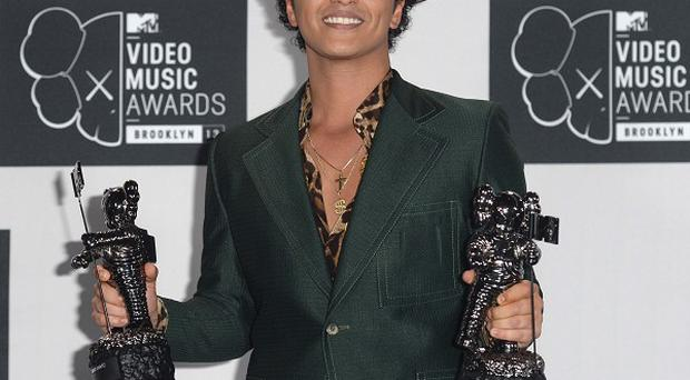 Bruno Mars is performing at the 2014 Super Bowl