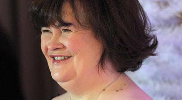 Susan Boyle's Christmas duet with Elvis Presley will raise money for charity