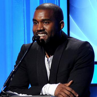 Kanye West has postponed tour dates after a large screen used during his shows was damaged (AP)