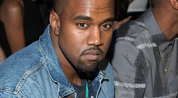 Kanye West faces charges over an alleged scuffle with a photographer (AP)