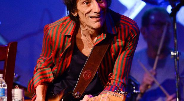 Ronnie Wood of the Rolling Stones performed with guitarist Mick Taylor in a rare club appearance at The Cutting Room on in New York (AP)