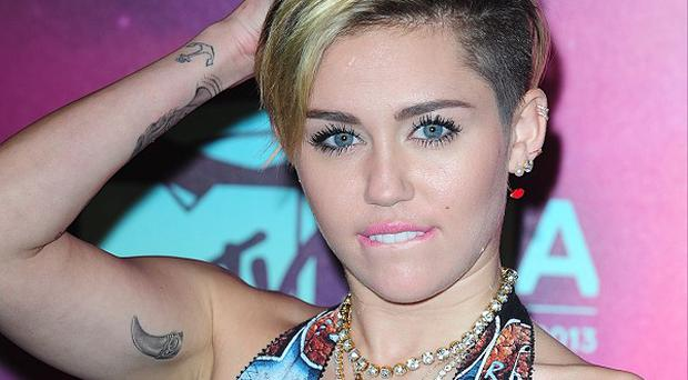 Miley Cyrus arrives for the 2013 MTV Europe Music Awards at the Ziggo Dome Amsterdam, Netherlands
