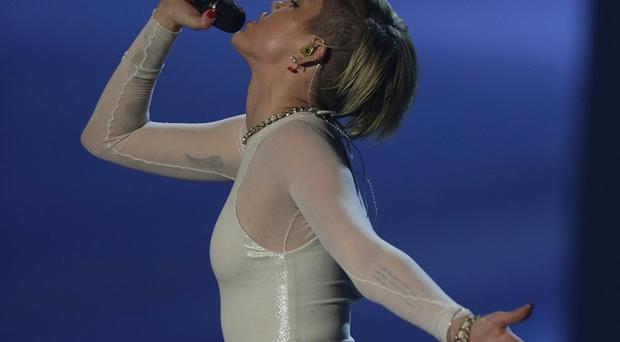 Miley Cyrus performs at the 2013 MTV Europe Music Awards in Amsterdam