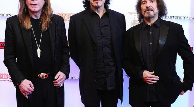 Ozzy Osbourne, Tommy Iommi and Geezer Butler of Black Sabbath attending The Classic Rock Roll of Honour at The Roundhouse