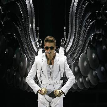Justin Bieber has said he hopes Argentines can forgive him for mistreating the country's flag