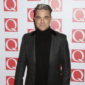 Robbie Williams could be set to equal Elvis Presley's chart-topping album tally