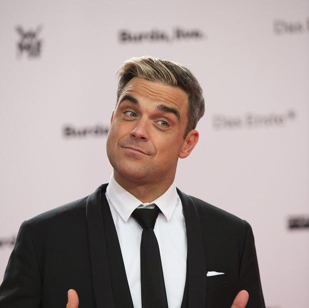 Robbie Williams is going on tour in 2014