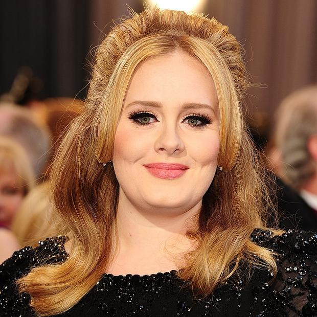 Adele has worked with rapper Wiz Khalifa